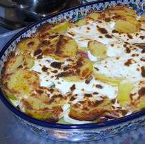 Rakott Krumpli Sonkaval:  an Hungarian layered casserole of potatoes, ham, and hard boiled eggs