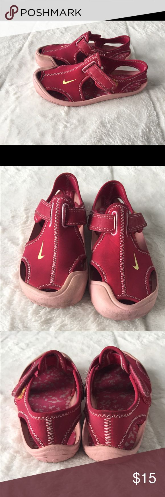 Girl Nike Protective Water Shoes/Sandals Good used condition! Give your girl a shoe that she'll want to wear for almost any occasion. A quick-dry upper combines with a molded rubber traction outsole to create a shoe that protects while she plays. Nike Shoes Water Shoes