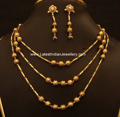 Trendy Multi layer chain with Gold Balls paired with earrings   Latest Indian Jewellery Designs