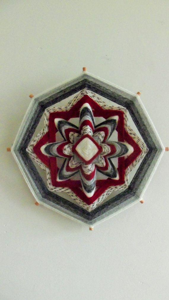 Ojo de dios La joyeuse fusion Mandala de fil réalisé par Lunhuevo