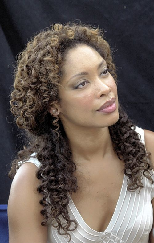 Gina Torres. Watch her in: Angel, The Matrix (2 & 3), Firefly, Serenity, Alias, Pushing Daisies, Drop Dead Diva