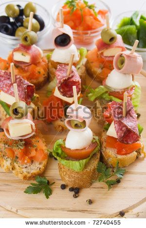 buffet Skewers display | Bruschetta, italian cold buffet with tomato, olive, ham and herbs ...