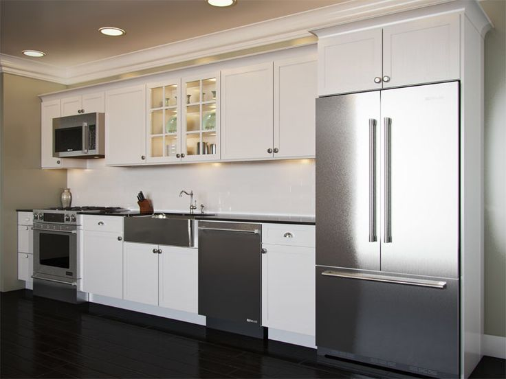 White, stone and stainless. Slide in range, over range microhood, stainless apron front sink, full size dishwasher, French door refrigerator.