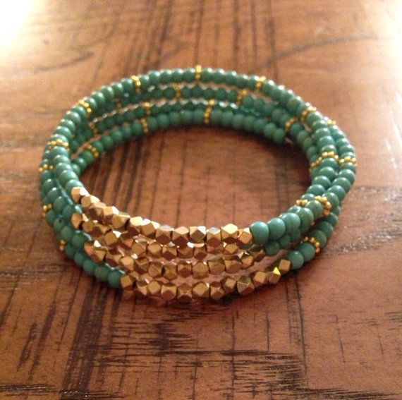 Simple and chic! This bracelet is one piece and gives the look of several (4) bracelets stacked together. Made with gold plated beads sprinkled