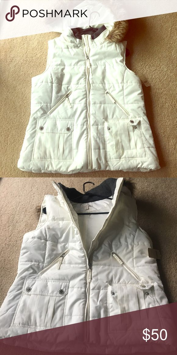 Ladies Cold Water Creek white zip up vest Ladies Cold Water Creek white zip up vest with faux fur laced hood. Brand new w/ tags. Never worn. Hood can be removed Coldwater Creek Jackets & Coats Vests