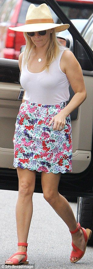 Cute: The pretty skirt finished several inches above her knees, meaning her lovely toned l...
