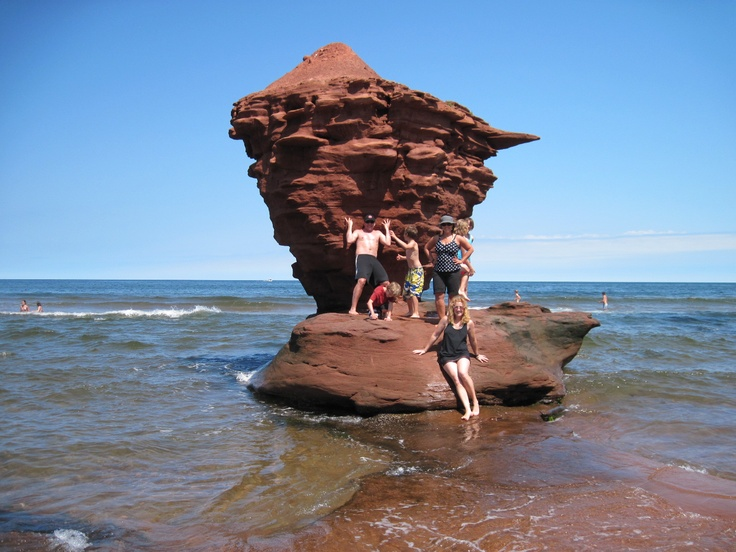 Holding up tea cup. Twin Shores Camping Area - Darnley, Prince Edward Island