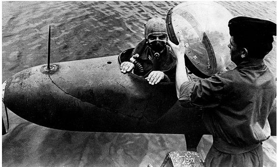 Frogmen ready for combat mission with a (self-propelled) one-man-torpedo (midget submarine) against allied navy vessel