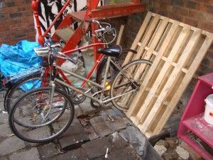 bike storage outside the studio made from a wooden pallet.