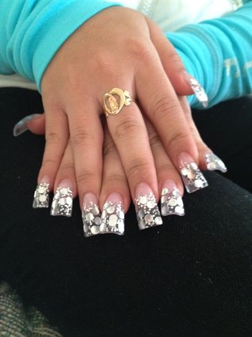 Flare Nails with Silver Polka Dots some people thinks its wierd but i love.them