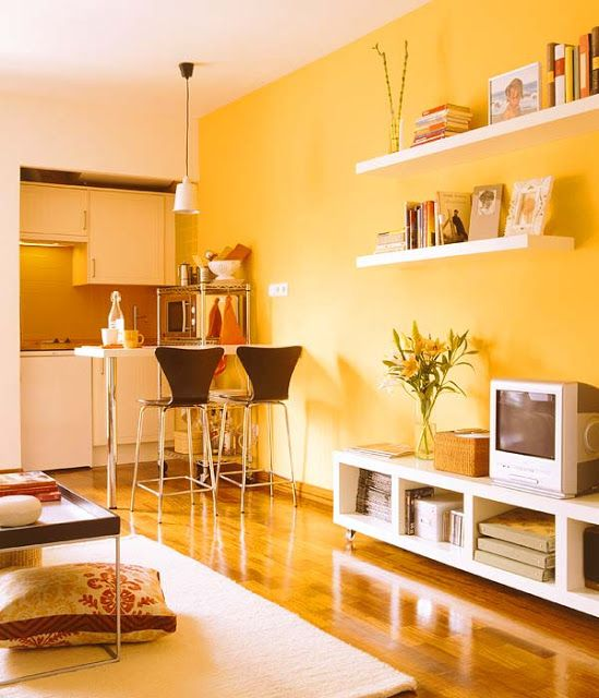 Small Apartment With Happy Yellow Wall And Smart Space Distribution