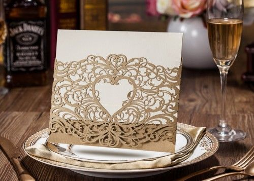 This exquisite invitation design featuring alluring gold laser cut patterned details is the ideal way to announce your celebration. From engagements to weddings this stand out design will work for bot