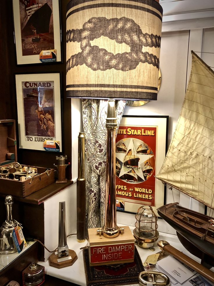 Take a look at our fabulous RMS Queen Elizabeth Tribute Lamp. Incorporating a Ships Brass and Copper Fire Hose Branch Nozzle and Ship Brass Plaque from the SS Vaal. The shade is provided by Cream of Cornwall adding an extra nautical theme to this the latest creation from The Brixham Steam Packet Company.