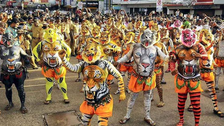 """September 19, 2013 marking the end of Onam celebration at Thrissur in Kerala with """"Puli kali"""" (Tiger Dance), a traditional Kerala art form."""
