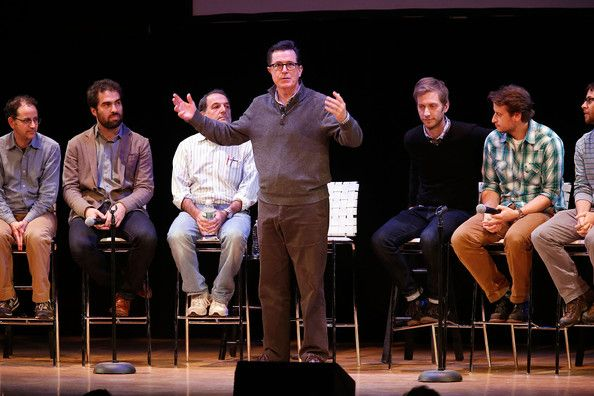 """Comedian/media personality Stephen Colbert speaks on stage with a panal of writers from the """"Stephen Colbert Show"""" during the panal """"A Lively Discussion With Stephen Colbert And His Writers"""" during the 2013 New York Comedy Film Festival at Town Hall on November 7, 2013 in New York City."""
