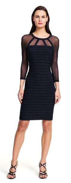 Illusion banded sheath dress Sheer mesh peeks through the neckline and sleeves of this curve-hugging sheath dress