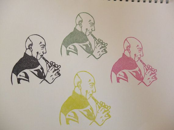 Captain Picard playing the flute. Hand carved by HandCarvedStamps