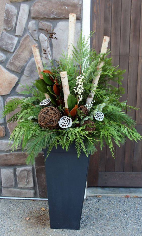 modern grey container with leaves, branches, flowers and lotus