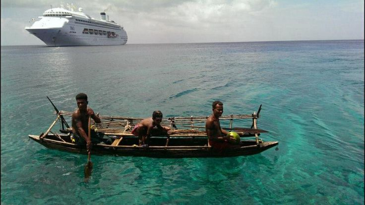PNG canoe with Pacific dawn in the background Papua New Guinea