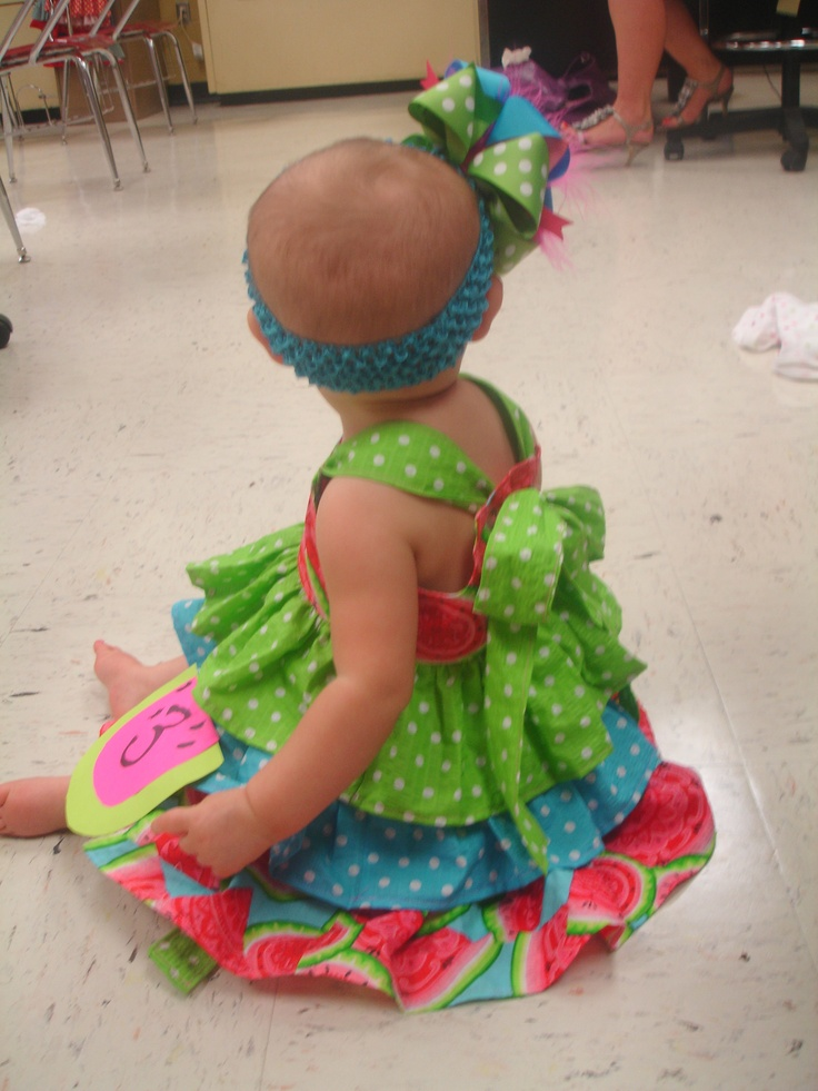 I love all the ruffles and how it ties into a bow in the back. She does great work.