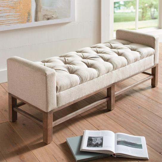 The Manchester Bench has an elegant shape that incorporates side arms for leaning and relaxing. Padded for comfort, this graceful bench in natural-hued    linen fabric is perfect at the end of your bed, or placed as impromptu seating in an entryway. A gorgeous, hand-tufted seat adds to the beauty of this    sophisticated style. It built with a sturdy, kiln-dried hardwood frame for wobble-free stability and steadfast service for years. Frame and legs    are finished with a stylish weathere...