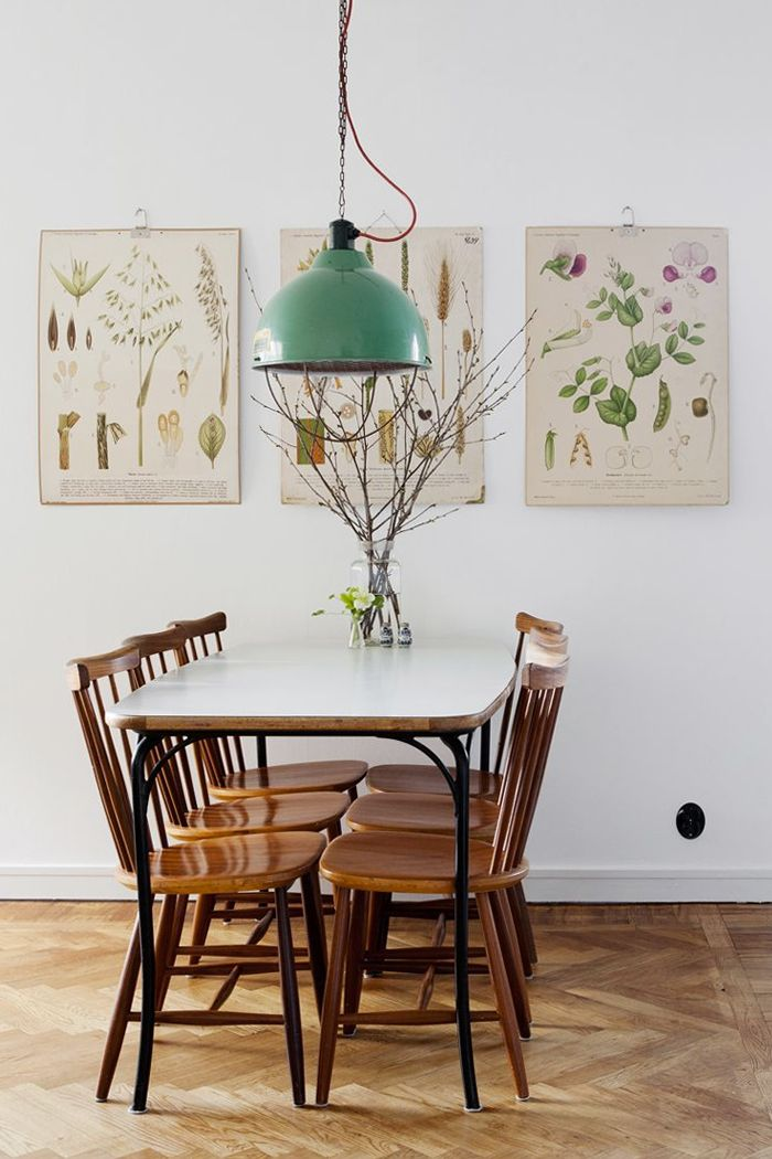 A collection of vintage botanical prints add charm to a dining nook.
