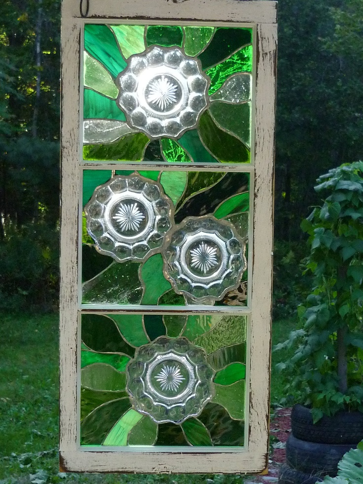 Stained glass window w/shades of green stained glass w/vintage Heisey plates in a reclaimed old window frame. $249.99, via Etsy.