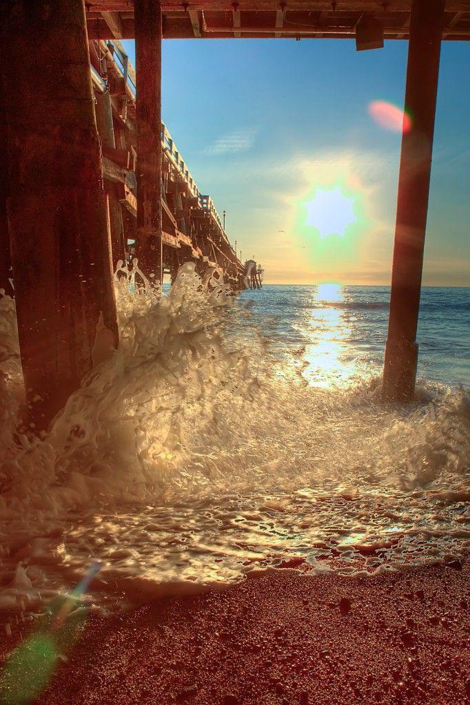 Beautiful shot of the water hitting the pier. Clemente Pier, California