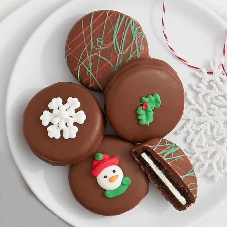 Christmas Oreo® cookies dipped in chocolate and topped with swizzles, snowflakes, holly and snowmen.
