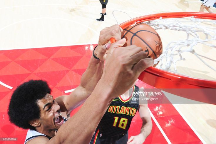 Jarrett Allen #31 of the Brooklyn Nets dunks the ball against the Atlanta Hawks on December 4, 2017 at Philips Arena in Atlanta, Georgia.