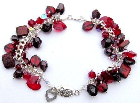 """Blingz the Thing Store - Sister Charm Bracelet, $65.00 (http://www.blingzthething.com/products/Sister-Charm-Bracelet.html)  This vibrant bracelet with a sterling silver sister link as the main focal point is surrounded on each side with a mix of Garnet nuggets, Swarovski crystals, and glass tablet beads, each elegantly suspended from a sterling silver chain. Finished with a lobster clasp – Length approx. 8.5"""""""