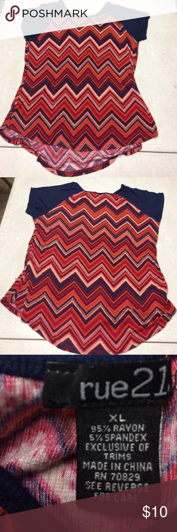 Chevron shirt sleeve top Chevron pink, orange, blue, cream short sleeve top. Style is longer in back than in front. Rue21 Tops