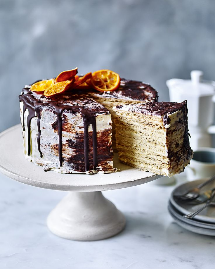 For a truly show-stopping dessert, try this Russian-inspired cake made from layered honey and orange biscuits, which have softened after soaking in the cream cheese icing.