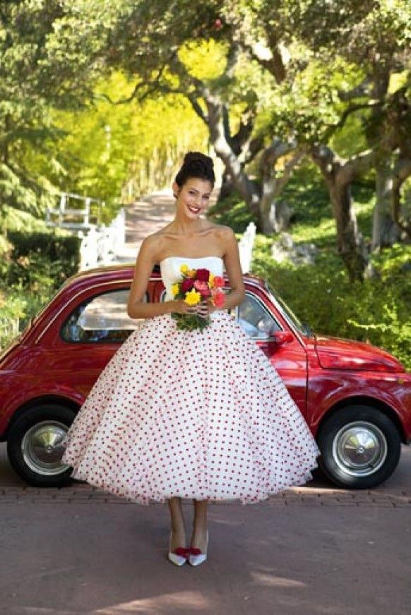 50s wedding dress. The red polka dots and mini in the background are an added bonus.
