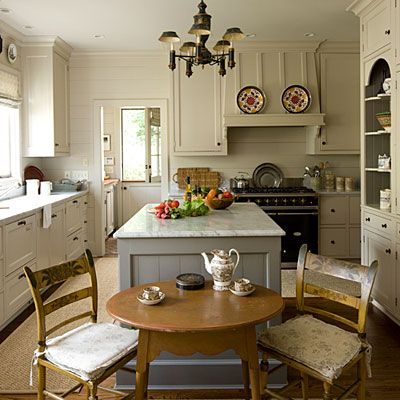 love the cabinet details, the island color, little french stove, horizontal paneling, and the dutch door!!