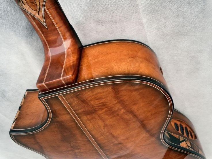 Pederson acoustic guitar back detail. Light tobacco burst over koa back and sides