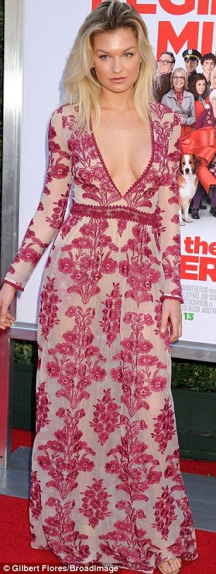 Flower power: Meredith Hennessy wore a floral design while Alex Borstein jumped on the mon...