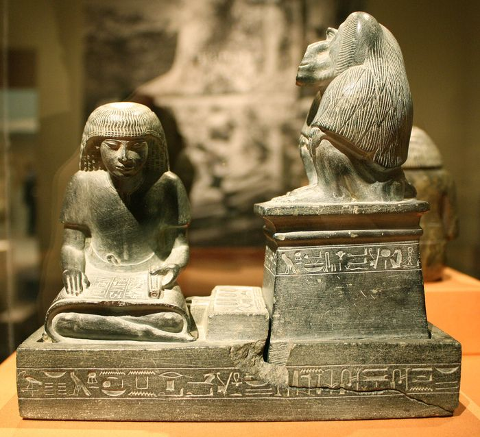 https://flic.kr/p/8UtkeT | A Magnificent Egyptian New Kingdom Greywacke Sculptural Group: The Royal Scribe Nebmerutef with the Baboon of the God Thoth | Graywacke, New Kingdom, Dynasty XVIII, Reign of Amenhotep III, ca. 1389-1349 B.C.E.  This work is among the most exquisite known images that pair a scribe with the baboon of Thoth. It consists of three separate pieces: base, scribe figure, and baboon. The inscriptions give Nebmerutef's titles, and written on the papyrus is a statement of…