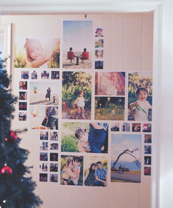 I really like the idea of a photo wall.  This one is made using decal frames!  (how cool!)