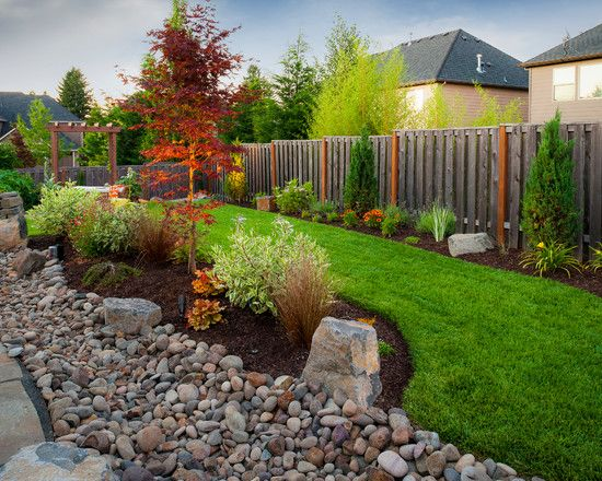 River Rock Landscaping Pictures for Your Inspiration : River Rock Landscaping Pictures In Traditional Landscape Using Bushes, Green Grass, And Japanese Model Fence