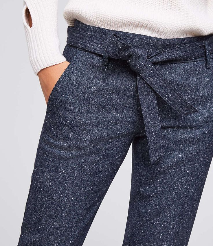 These tweed pants are topped with a tie waist