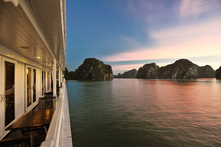 Halong Bay - Sunset view from balcony Paradise Cruise http://halongtrippy.com/paradise-luxury-cruise
