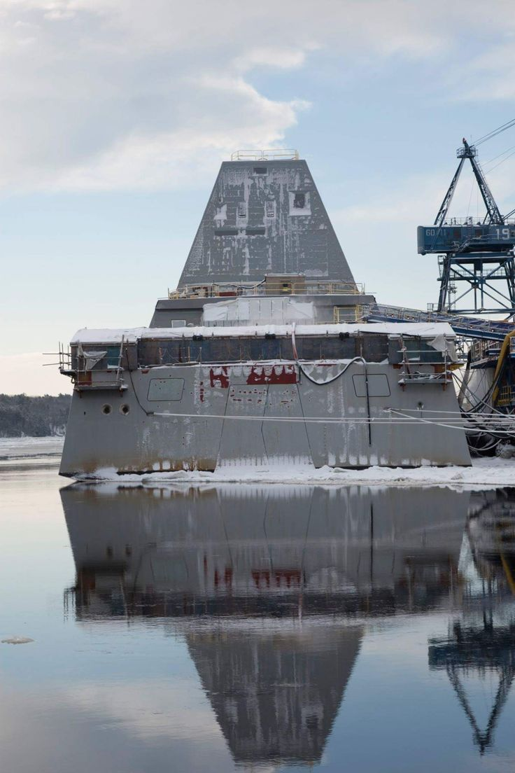USS Zumwalt tied up pier side on a calm winter day. [1365x2048]