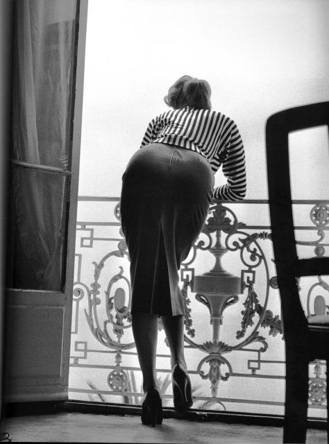Sophia Loren looking at the sea from her room in the Carlton Hotel in Cannes in 1955.