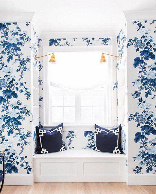 Blue floral wallpaper + built-in window seat.