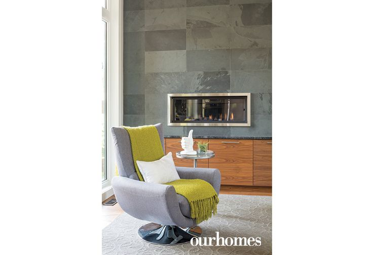 A built-in fireplace keeps the main floor feeling cosy in cold weather. http://www.ourhomes.ca/articles/build/article/uptown-rebuild-catalyzes-neighbourhood-change?full=true#sthash.qnbcxpPy.dpuf