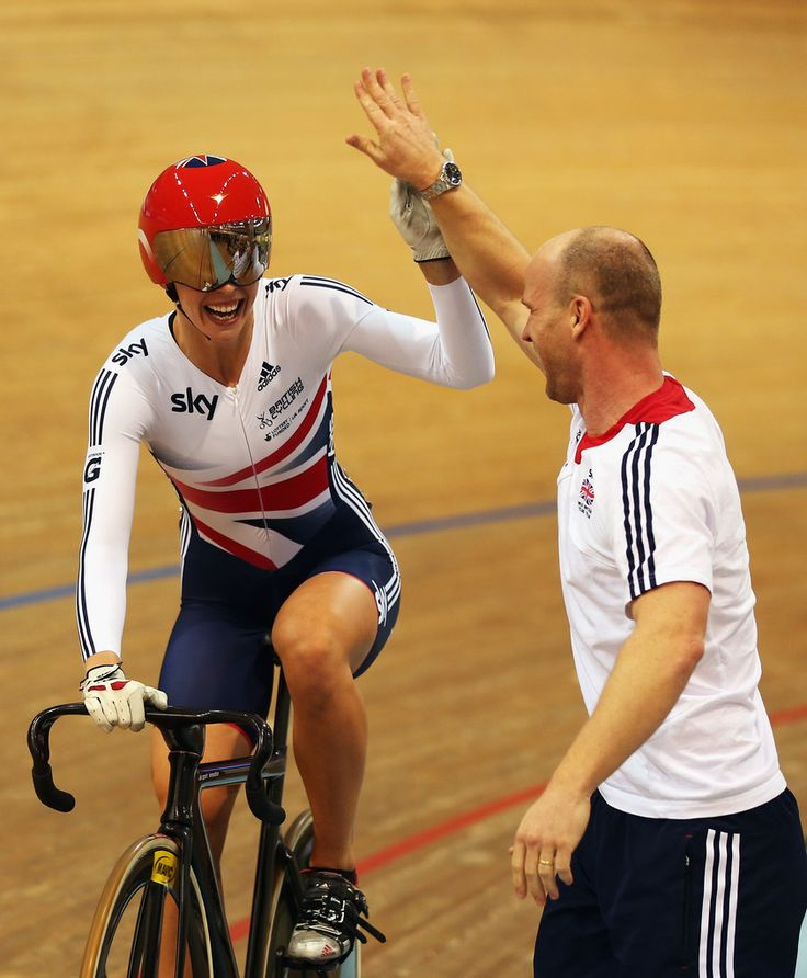 Rebecca James Photos - Rebecca James of Great Britain celebrates with Great Britain Sprint Coach Jan Van Eijden after winning the Women's Keirin final on day five of the 2013 UCI Track World Championships at the Minsk Arena on February 24, 2013 in Minsk, Belarus. - UCI Track World Championships - Day Five