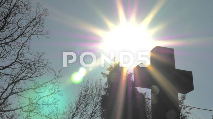 4K Stone Cross Silhouette Sunlight Lens Flare Trees Blue Sky - Stock Footage | by RyanJonesFilms