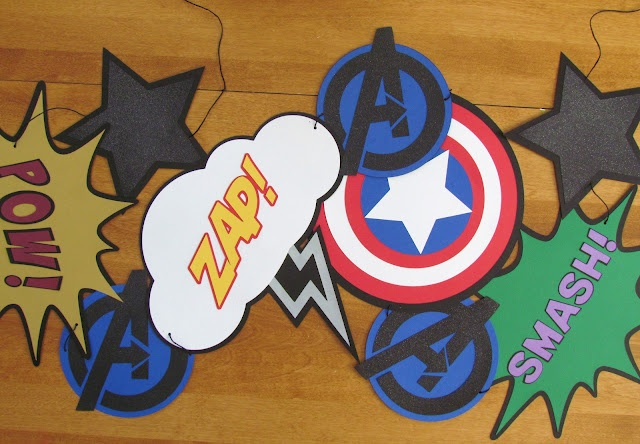 This link is for an Avengers Birthday Banner, but I'm thinking super hero bulletin board...