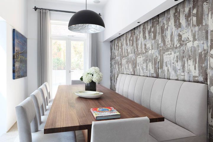A gracious dining table makes use of this narrow room in a #CardenCunietti project. The peekaboo #metallic pendant light takes this space to the next level!